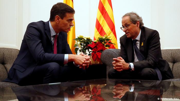 Spain's Prime Minister Pedro Sanchez and Catalan leader Quim Torra in Barcelona