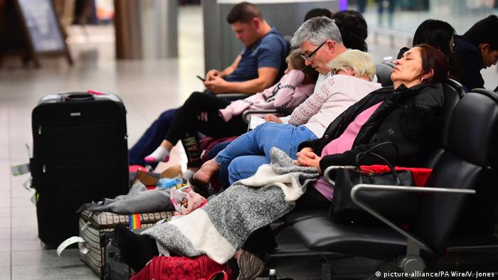 People waiting or sleeping on seats at the Gatwick airport