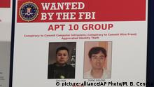 20.12.2018 A poster displayed during a news conference at the Department of Justice in Washington, Thursday, Dec. 20, 2018, shows two Chinese citizens suspected to be with the group APT 10 carrying out an extensive hacking campaign to steal data from U.S. companies. The Justice Department is charging two Chinese citizens with carrying out an extensive hacking campaign to steal data from U.S. companies. An indictment was unsealed Thursday against Zhu Hua and Zhang Shillong. Court papers filed in Manhattan federal court allege the hackers were able to breach the computers of more than 45 entities in 12 states. (AP Photo/Manuel Balce Ceneta)  