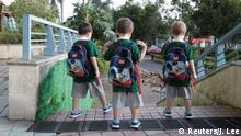 An Hui's and Ye Jianbin's sons, An Zhizhong, An Zhifei and An Zhiya, walk to kindergarten in Shenzhen, Guangdong province, China September 18, 2018. An and Ye are fathers of triplets who were conceived with the help of a German egg donor. REUTERS/Jason Lee SEARCH LGBT TRIPLETS FOR THIS STORY. SEARCH WIDER IMAGE FOR ALL STORIES.