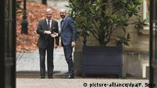 Belgium's Prime Minister Charles Michel, right, prepares to shake hands with Belgium's King Philippe during consultations at the Royal Palace in Brussels, Friday, Dec. 21, 2018. Prime Minister Charles Michel holds talks with Belgium's King Philippe as the monarch weighs whether to accept the premier's resignation and name him at the head of a caretaker government until elections are held in May. (AP Photo/Francisco Seco) |
