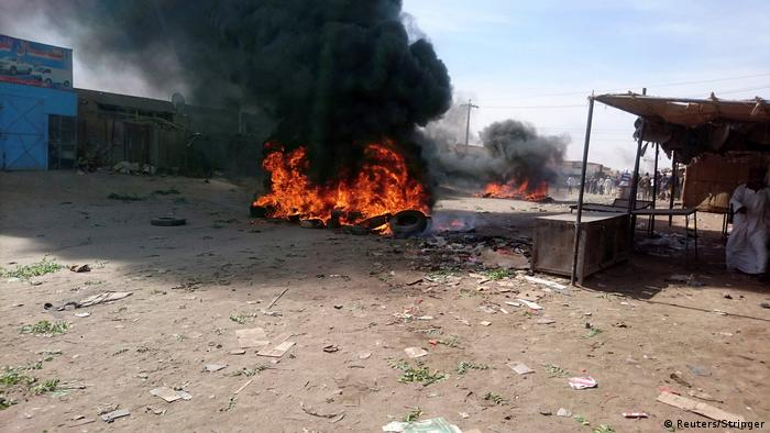 Protesters in the city of Atbara, north of Khartoum, set up bonfires during demonstrations