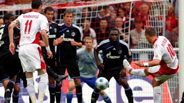 Cologne's Lukas Podolski scores a freekick against Schalke