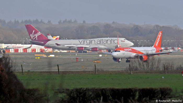 A Virgin Atlantic and Easyjet plane ready for takeoff at London's Gatwick airport