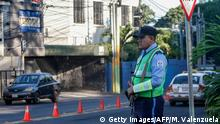 A policeman controls traffic in front of the 100% Noticias (100% News) televison station in Managua, on December 22, 2018 a day after the station was raided and closed by the Nicaraguan Police. - The director of 100% Noticias, Miguel Mora, was arrested during the raid. Rights groups say at least 320 people have been killed in Nicaragua in a brutal government crackdown launched in response to the escalation in April of street protests, initially against a now-ditched pension reform. (Photo by MAYNOR VALENZUELA / AFP) (Photo credit should read MAYNOR VALENZUELA/AFP/Getty Images)