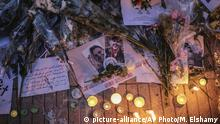 Flowers, candles and messages are laid during a vigil outside the Norwegian embassy in Rabat for two Scandinavian university students who were killed in a terrorist attack in a remote area of the Atlas Mountains, Morocco, Saturday, Dec. 22, 2018. Moroccans gathered Saturday in front of the Norwegian and Danish embassies in Rabat in a candlelight vigil to honor two Scandinavian university students killed in a terrorist attack in the Atlas Mountains. (AP Photo/Mosa'ab Elshamy) |