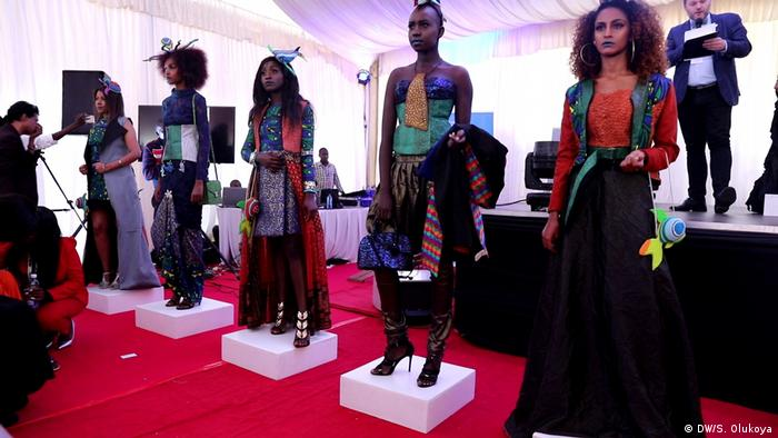 Five fashion models showcase designs from a so-called blue fashion collection (DW/S. Olukoya)