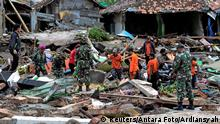 Rescue team members search for victims among debris after a tsunami hit at Rajabasa district in South Lampung, Indonesia, December 23, 2018 in this photo taken by Antara Foto. Antara Foto/Ardiansyah/ via REUTERS ATTENTION EDITORS - THIS IMAGE WAS PROVIDED BY A THIRD PARTY. MANDATORY CREDIT. INDONESIA OUT.