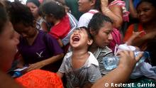 A Central American migrant, part of a caravan trying to reach the U.S., reacts as he waits to apply for asylum in Mexico at a checkpoint in Ciudad Hidalgo, Mexico, October 20, 2018. Reuters photographer Edgard Garrido: A small Honduran child cried as the oppressive heat, uproar from the surrounding crowd and hours of waiting with his mother to enter Mexico legally became too much to bear. The image conveys the plight faced by many families traveling with children in tow, where fatigue, uncertainty, and the elements have an added level of drama. After traveling to the Mexico-Guatemala border, many of the migrants then had to wait three or four days on the bridge for Mexican authorities to let them cross the border. The wait is long and tedious, but hours after this picture was taken, the wailing child and mother were both let into Mexico. This scene, and others like it, hit home. A lack of opportunities, endemic violence and poverty prompted these families to abandon their homeland and embark on this arduous journey. The challenge in taking these pictures is getting to know the people, documenting this incredibly transcendental moment in their lives and conveying their humanity as truthfully as possible. I have been covering migrants since 2006 and followed this particular caravan of migrants for two weeks as they traveled through Guatemala to the Mexican border. As a photographer you have to make sure you put yourself in the right place and have the right light. Sometimes that is more obvious than others. In chaotic situations like this in the midst of hundreds of people, my experience and intuition guide me. I go searching for the light and underneath it inevitably there will be incredible moments to photograph. REUTERS/Edgard Garrido SEARCH IMMIGRATION POY FOR THIS STORY. SEARCH REUTERS POY FOR ALL BEST OF 2018 PACKAGES. TPX IMAGES OF THE DAY.