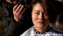Li Wenzu has her head shaved to protest the detention of her husband and Chinese human rights lawyer Wang Quanzhang, detained during the 709 crackdown, in Beijing on December 17, 2018. - Li and a group of women protested the detention of their husbands who have have been held since 2015 when more than 200 lawyers and activists were detained in a swoop, known as the 709 crackdown, on those who had taken on civil rights cases considered sensitive by China's tightly controlled courts. (Photo by FRED DUFOUR / AFP) (Photo credit should read FRED DUFOUR/AFP/Getty Images)