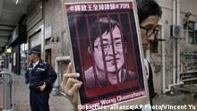 A protester in 2018 hold an image of jailed Chinese human rights lawyer Wang Quanzhang