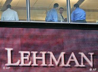 Men in suits inside the Lehman Brothers office building