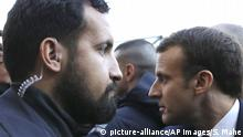 24.02.2018 Elysee senior security officer Alexandre Benalla, left, stands next to French President Emmanuel Macron during a visit to the Paris International Agricultural Show (Salon de l'Agriculture) in Paris, February 24, 2018. (Stephane Mahe/Pool via AP) |
