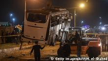 This picture taken on December 28, 2018 shows a tourist bus which was attacked being towed away from the scene, in Giza province south of the Egyptian capital Cairo. - Three Vietnamese holidaymakers and an Egyptian tour guide were killed December 28, 2018, when a roadside bomb blast hit their bus as it travelled close to the Giza pyramids outside Cairo, officials said. (Photo by Mohamed el-Shahed / AFP) (Photo credit should read MOHAMED EL-SHAHED/AFP/Getty Images)