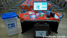 FILE PHOTO: An electronic voting machine and a ballot box are seen inside the Congo's electoral commission (CENI) head offices at the Gombe Municipality in Kinshasa, Democratic Republic of Congo, March 1, 2018. REUTERS/Robert Carrubba/File Photo
