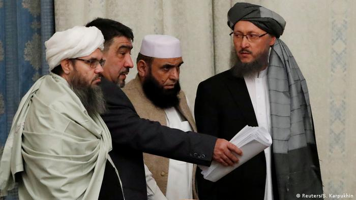 Members of Taliban delegation take their seats during peace talks on Afghanistan in Moscow, Russia, November 2018