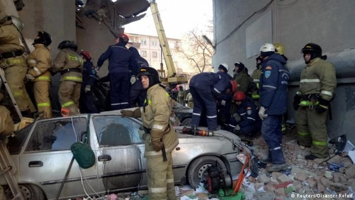 Emergency personnel work at the site of the collapsed apartment building in Magnitogorsk, Russia (Reuters/Disaster Releif)
