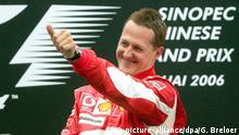 01.10.2006 German Formula One driver Michael Schumacher of Scuderia Ferrari team celebrates on the podium after he won the Grand Prix of China at the F1 racetrack near Shanghai, China, Sunday 01 October 2006. Photo: Gero Breloer +++(c) dpa - Bildfunk+++ | Verwendung weltweit