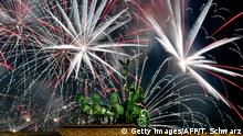 Fireworks explode behind the quadriga of Berlin's landmark the Brandenburg Gate to usher in the New Year on January 1, 2019. (Photo by Tobias SCHWARZ / AFP) (Photo credit should read TOBIAS SCHWARZ/AFP/Getty Images)