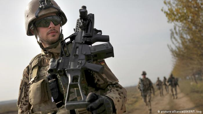A German soldier marching in Afghanistan