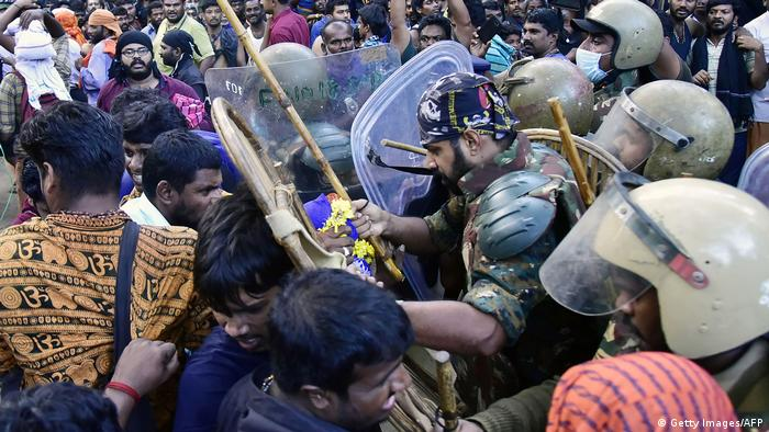Police wielding bamboo sticks scuffle with protesters (Getty Images/AFP)