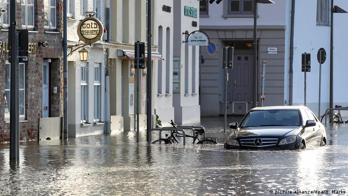 A car stuck in floodwaters