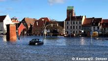 The storm flooded streets and squares in the old town near the harbor of Wismar in northern Germany.