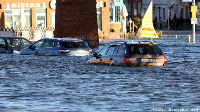 Cars stuck in floodwater on Wismar harbor.