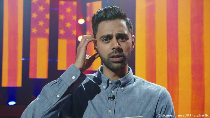 In this image released by Netflix, comedian Hasan Minhaj appears in a scene from his Netflix special, Homecoming King. Minhaj is kicking off a 16-city North American tour starting in August and this fall will host his own weekly comedy show for Netflix