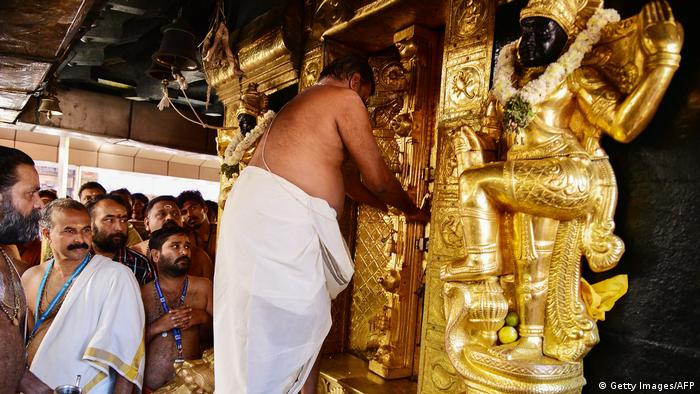 A priest faces a gilded shrine of Ayyappa (Getty Images/AFP)