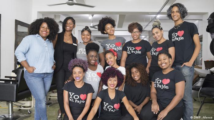 6f0638a7fb Carolina Contreras and her team at Miss Rizos salon in Santo Domingo in the  Dominican Republic