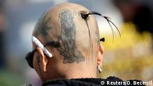 January 1, 2019*** A follower shows on his head a tattoo of La Santa Muerte (The Saint of Death), a cult figure often depicted as a skeletal grim reaper, in Tepito neighbourhood, in Mexico City, Mexico January 1, 2019. REUTERS/Daniel Becerril