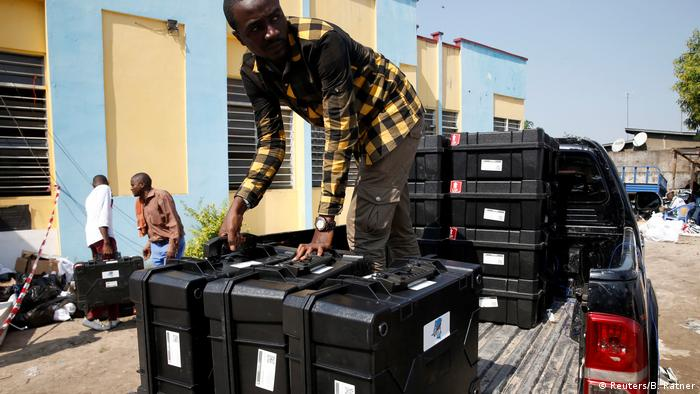 A man returns voting machines used in the elections to the national tallying center in Kinshasa