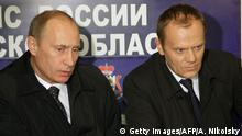 Russia's Prime Minister Vladimir Putin (L) and his Polish counterpart Donald Tusk attend a video conference as they visit the site of a Polish government Tu-154 aircraft crash, at the airport in Smolensk on April 10, 2010. A plane carrying Polish president Lech Kaczynski and much of the country's military and state elite crashed in thick fog in Russia on Saturday killing all 96 people on board in a blazing inferno. AFP PHOTO / RIA NOVOSTI / POOL / ALEXEY NIKOLSKY (Photo credit should read ALEXEY NIKOLSKY/AFP/Getty Images)