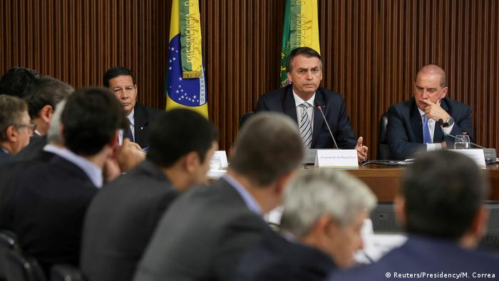 Brazil's President Jair Bolsonaro attends a meeting with all his ministers at the Planalto Palace in Brasilia.