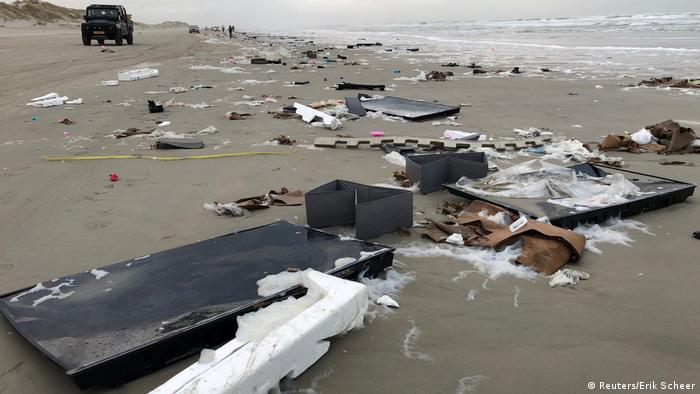 Flat-screen television sets and debris lie washed up on a beach in Terschelling (Reuters/Erik Scheer)