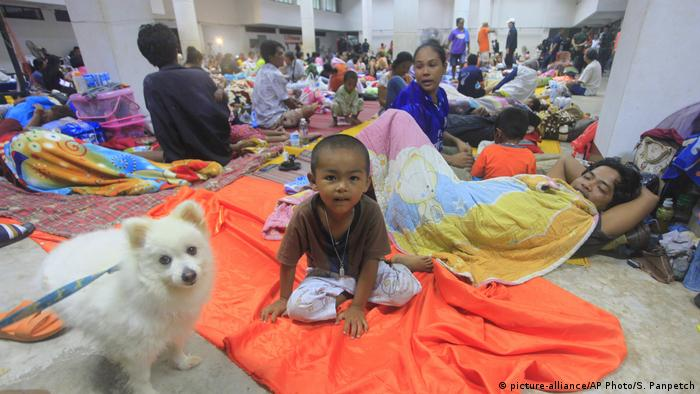 Thai people sleep at an evacuation center in Nakhon Si Thammarat province