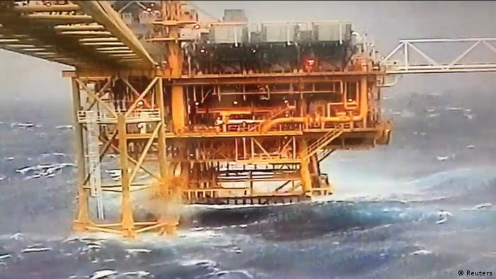 Waves crash along an oil rig as tropical storm Pabuk reaches the Gulf of Thailand