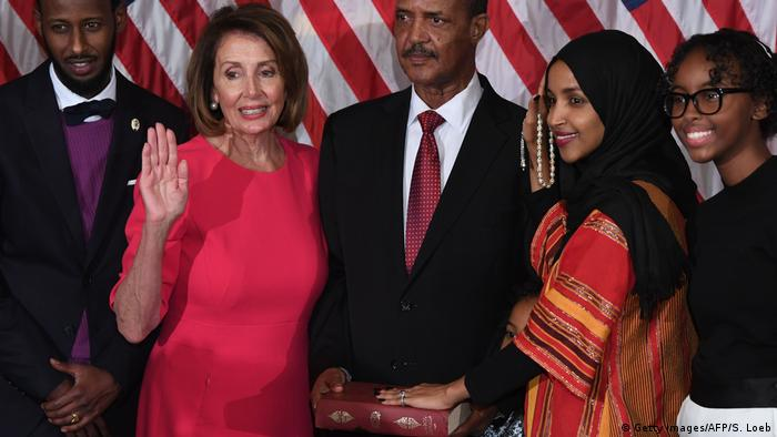 Speaker of the House Nancy Pelosi (left) performs a ceremonial swearing-in for US House Representative Ilhan Omar
