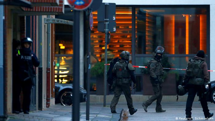 German special police leave a building near the area where shots were fired in Cologne, Germany.