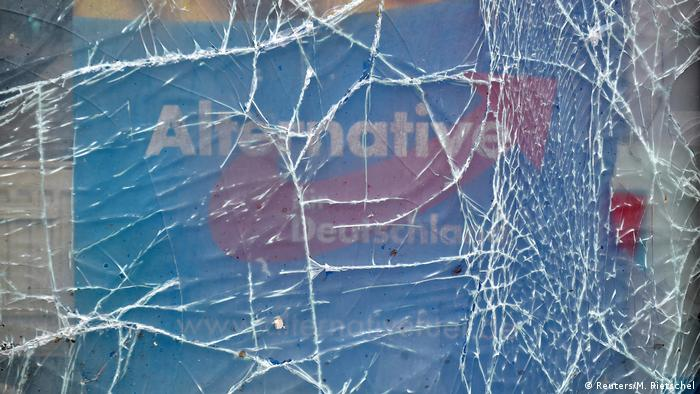 Shattered glass in front of AfD office