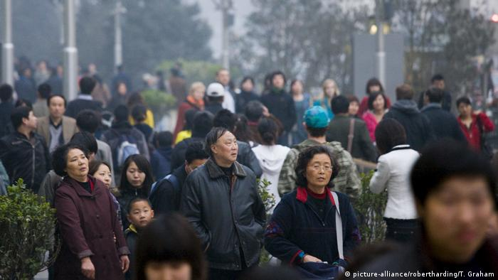Crowded street corner of Chang An Avenue and Wangfujing Street in Beijing