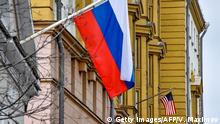 Russian flag outside the building of the embassy of the United States of America in Moscow