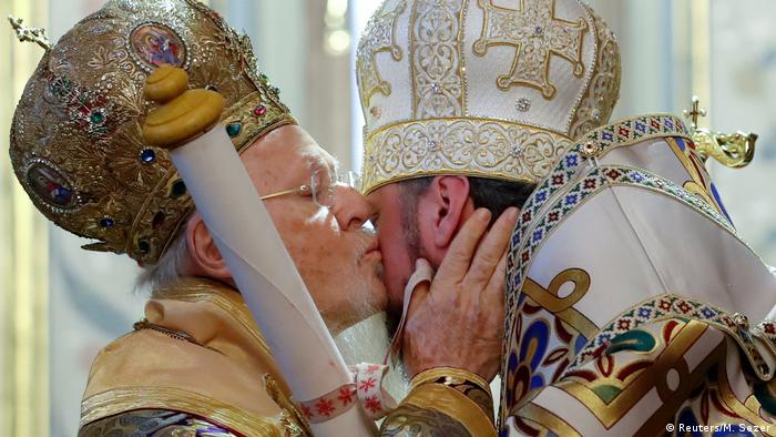 Ecumenical Patriarch Bartholomew I kisses Metropolitan Epifaniy, head of the Orthodox Church of Ukraine