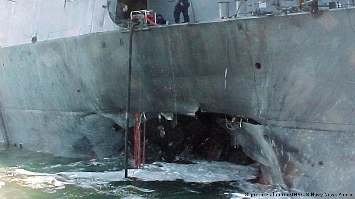 A side view showing the huge hole in the hull of the US Navy destroyer caused by the explosion of a suicide bomb