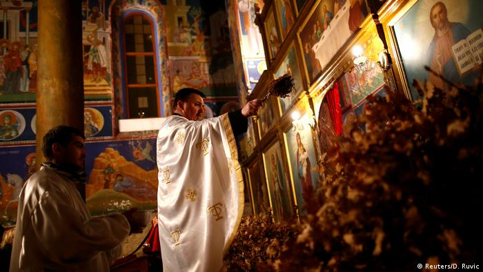 osnian Orthodox priest Marko Males leads a mass on the eve of Orthodox Christmas in Church of the Holy Mother of God in Zenica, Bosnia and Herzegovina (Reuters/D. Ruvic)