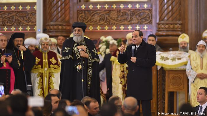 Egyptian President Abdel-Fattah al-Sisi (R) speaks as Coptic Pope Tawadros II listens on during the inauguration of the Cathedral of the Nativity of Christ in the new administrative capital
