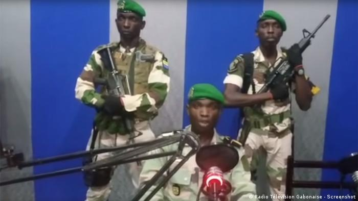 Soldiers on Gabonese television during the coup attempt