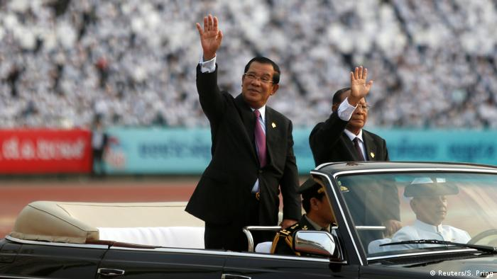 Cambodian Prime Minister Hun Sen salutes the crowd
