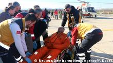 Medics carry a sailor who is survived by members of Turkish Coast Guard Command, upon his arrival at a local airport in Samsun, Turkey January 7, 2019. Yaprak Kocer/Demiroren News Agency (DHA) via REUTERS ATTENTION EDITORS - THIS PICTURE WAS PROVIDED BY A THIRD PARTY. NO RESALES. NO ARCHIVE. TURKEY OUT. NO COMMERCIAL OR EDITORIAL SALES IN TURKEY.